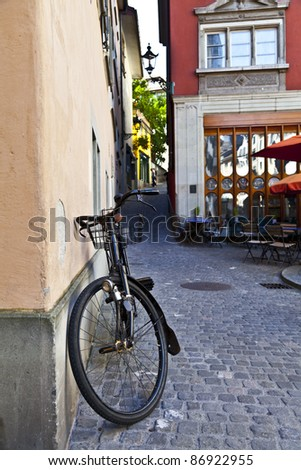 Old Bicycle in Zurich Streets - stock photo