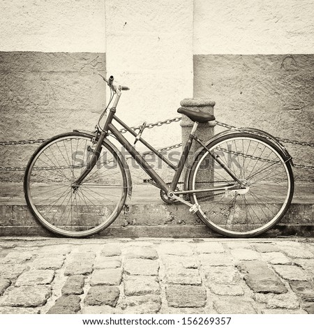 Old bicycle on ancient street in black and white style