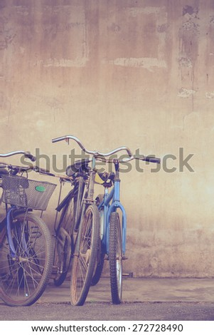 Old bicycles parking outside the repair shop waiting to be fixed in retro tone - stock photo