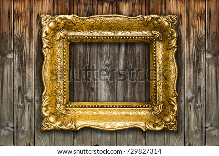 Old Big Picture Frame on wooden background