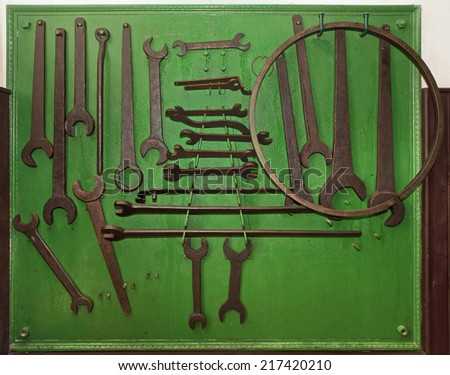 old big spanners in a green plant - stock photo