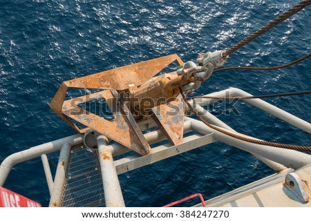 old big steel anchor with sling and shackles - stock photo