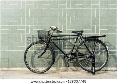 Old bike against the wall - stock photo