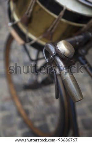 Old bike and drum in a flea market - stock photo