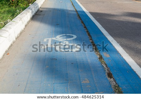 Old bike lane with blue background texture