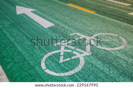Old bike track , bicycle symbol have deteriorate and wave - stock photo
