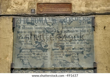 old billboard in Florence, Italy with a torn public announcement - stock photo