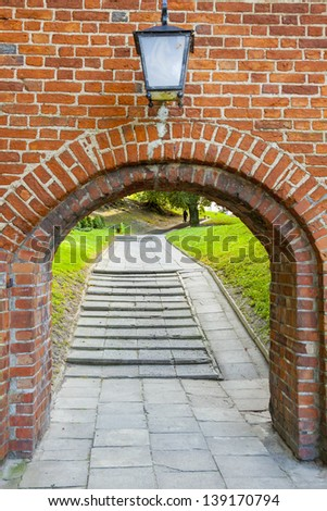Old birck wall - entry to Cathedral in Frombork. - stock photo