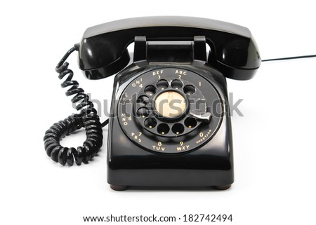 old black antique rotary style telephone - stock photo