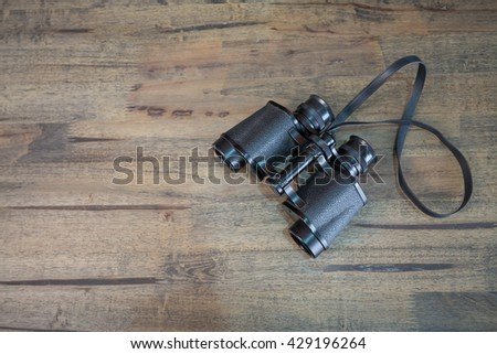 old black binoculars with top view on wooden table awesome office table top view shutterstock id