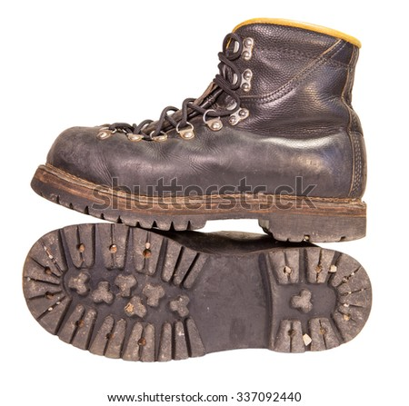 Old black boots trekking production of the USSR, isolated on a white background. - stock photo