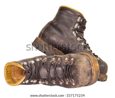 Old black boots trekking production of the USSR, isolated on a white background.
