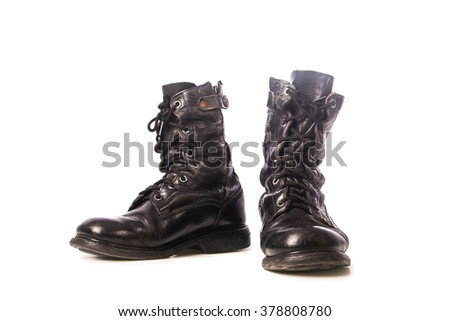 old black combat boots on white background - stock photo