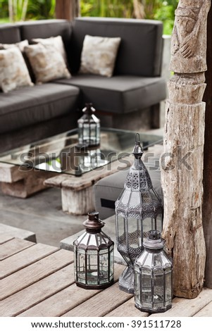 Old black metal vintage lamps in grey exterior. Outside decor - stock photo