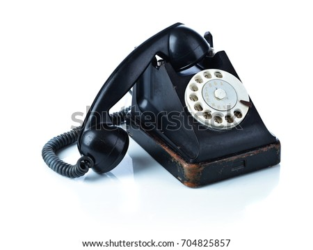 Old black phone isolated on a white background.