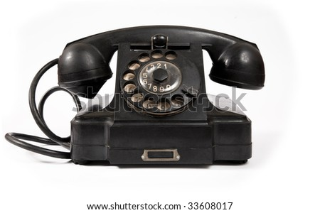 Old black phone with dust and scratches, isolated on white background