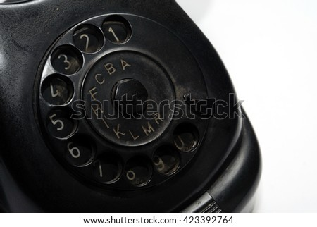 Old black phone with dust and scratches, isolated on white background - retro - stock photo