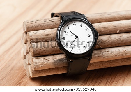 old black plastic fashion wristwatch with scratch - stock photo