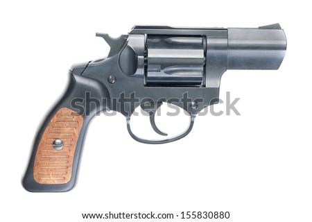 Old black revolver with wooden grip. - stock photo