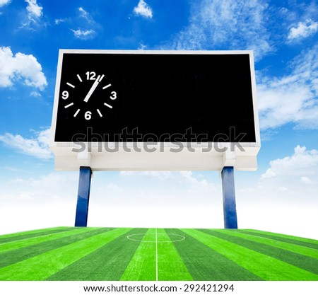 Old black score board in field soccer with blue sky view from stadium. - stock photo