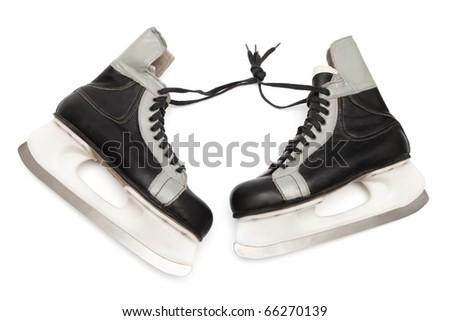 old black skates on white background - stock photo