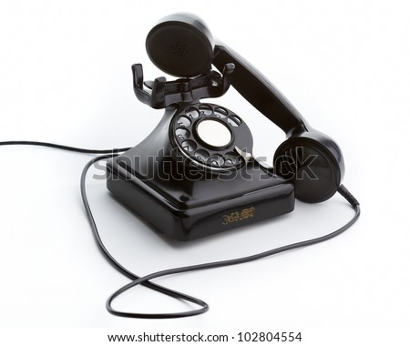 Old black steel and bakelite telephone off the hook. Shot at 3/4.