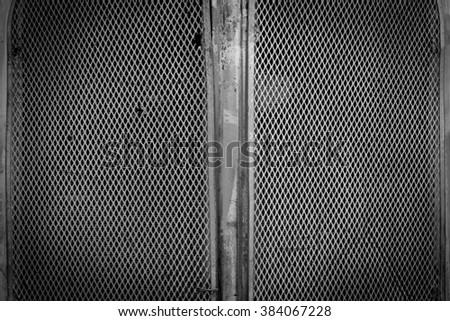 old black steel metal mash texture background - stock photo