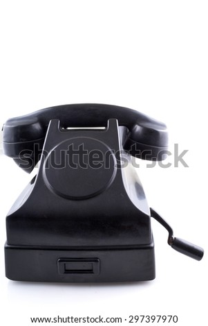 Old black vintage telephone with rotary dial on white background - stock photo