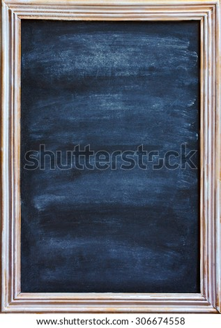 Old blackboard with white chalk and eraser for menu or price.  - stock photo