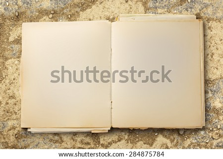 Old blank notebook open on colorful background  - stock photo
