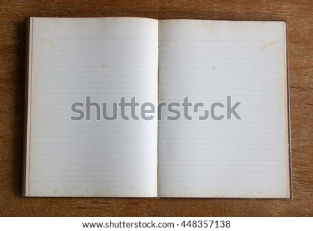 old blank page of notebook on wood table - stock photo