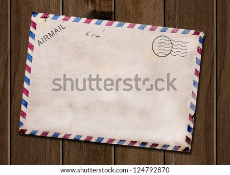 Old blank post card wooden background. - stock photo