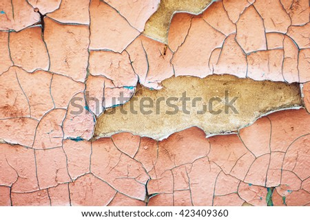 old blue and pink paint texture closeup. blue  and pink cracked and peeling paint background with texture. Peeling paint on wall seamless texture. Pattern of rustic blue grunge material. - stock photo
