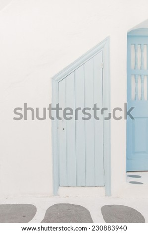 Old blue door and steps, painted white. Greece. Mykonos - stock photo