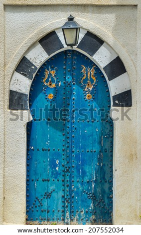 Old Blue door with arch from Sidi Bou Said in Tunisia - stock photo