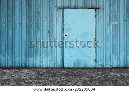 Old blue metal door background. - stock photo