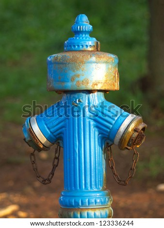 old blue rusty water hydrant - stock photo