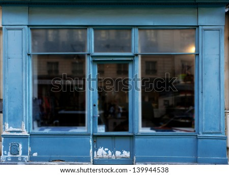 Old blue shop in Paris with lots of copy space - stock photo