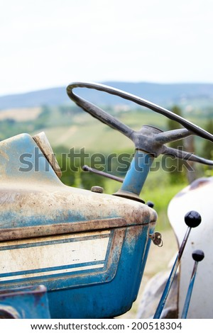 Old blue  tractor details in the vines field  - stock photo