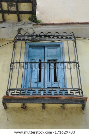 Old blue window with steel railings - stock photo