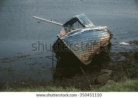 Old boat abandoned on the coastline in Ireland. County Donegal