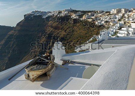 Old boat and Panoramic view to towns of Imerovigli and Firostefani, Thira, Cyclades, Greece - stock photo