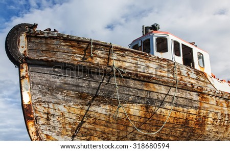 old boat hull in dry dock - stock photo