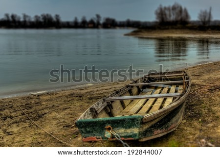 Old boat in the river shore