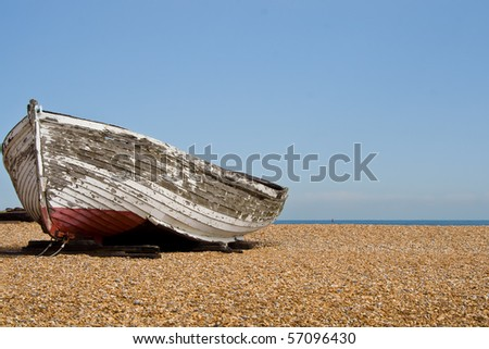 Old boat on a shingle beach