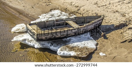 old boat on the beach - stock photo