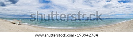 Old boat on the beach - panoramic view - stock photo