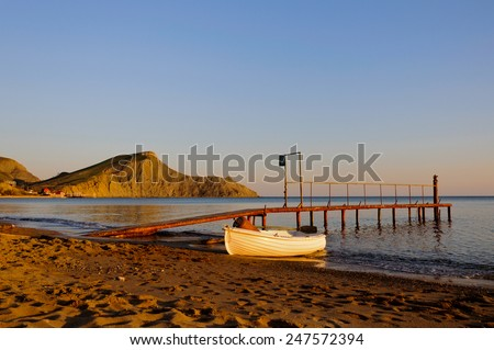 Old boat on the old pier. - stock photo