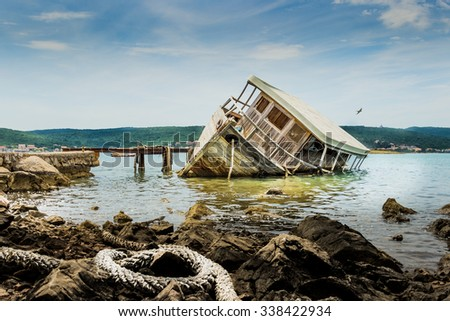 Old boat sinking. - stock photo