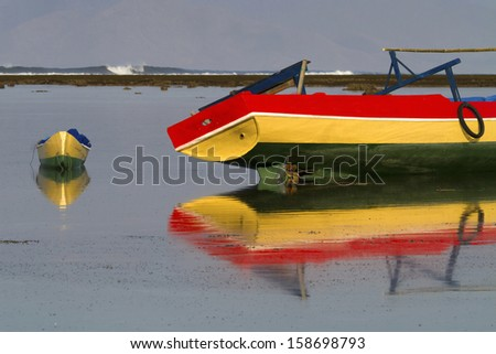 Old boats in the shallows